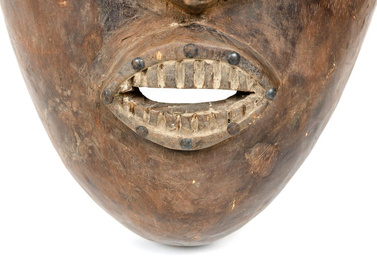 Hand-Carved Decorative African Tribal Mask For Sale