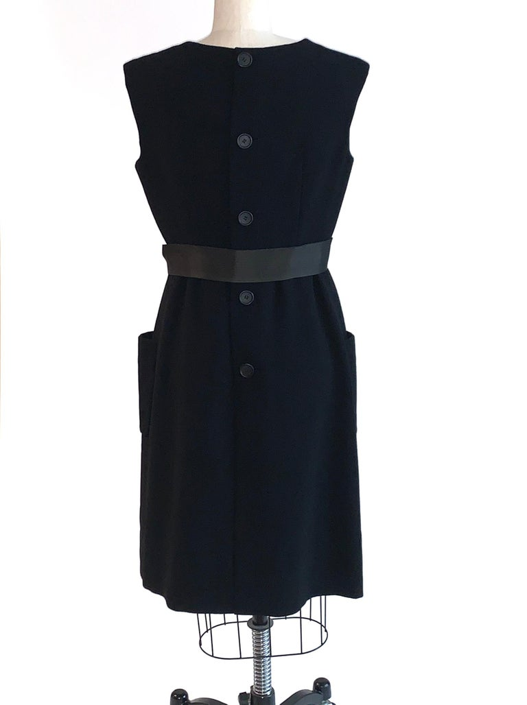 Women's 1960s Norman Norell Black Shift Dress with Patch Pockets and Ribbon Belt For Sale