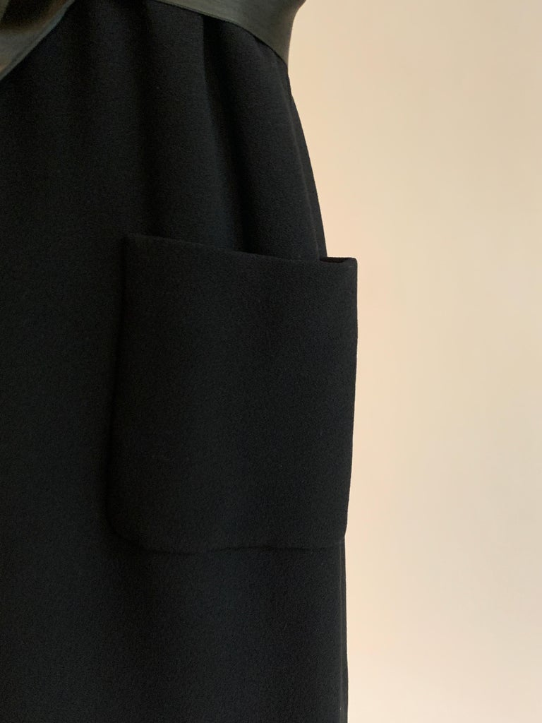 1960s Norman Norell Black Shift Dress with Patch Pockets and Ribbon Belt For Sale 2