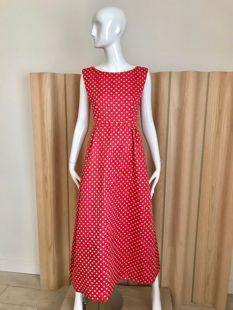 Classic Vintage Norman Norell early 60s sleeveless maxi silk dress in dark pink color with cream polka dots. Dress comes with matching  crop fitted jacket with silk Pom Pom buttons. Measurement: Bust: 34 inches / Waist: 28 inches/ Dress length: 50.5
