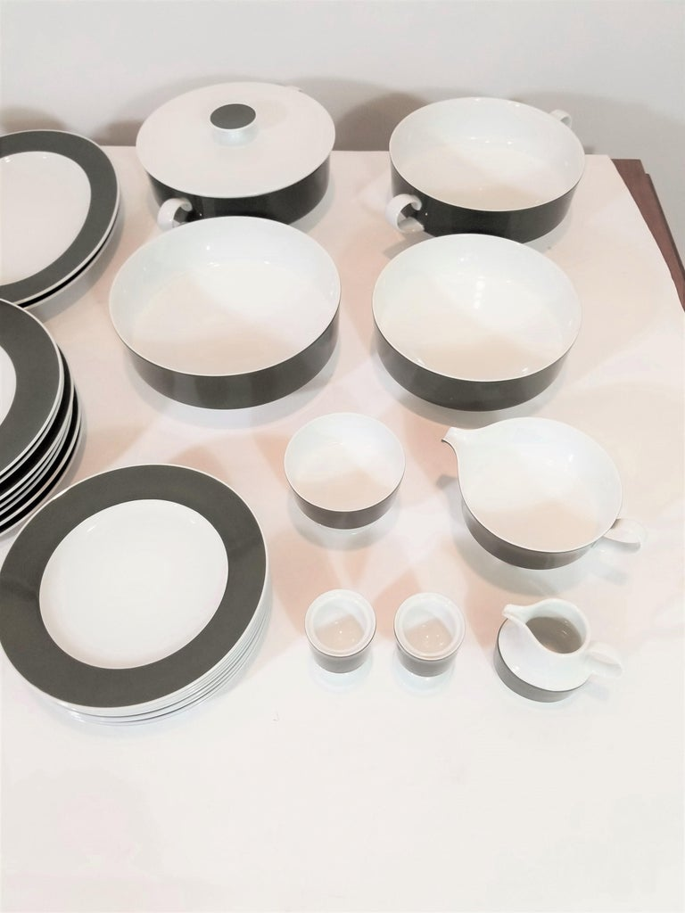 1960 midcentury dinner set consisting of 63 pieces. Elegant and modern design consistent with 1960s midcentury. The Versatile color and design allows for formal use as well as less formal. All pieces are porcelain and Marked Rosenthal.  Excellent