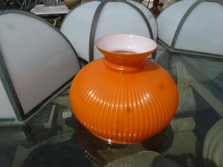 1960's orange glass lampshades. 