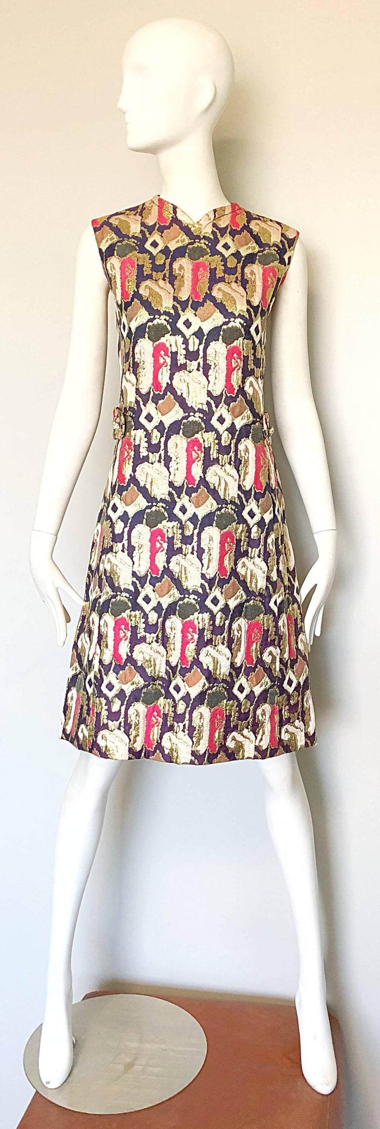Fabulous 1960s OSCAR DE LA RENTA silk brocade A Line dress and coat ensemble! Features lovely abstract prints in gold, purple and pink. Jacket features a sharp tailored bodice with a slightly flared body. Pockets at each side of the hips. Double