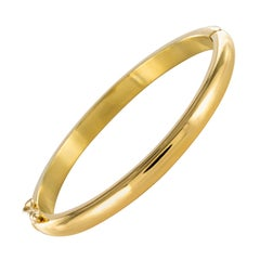 1960s Oval 18 Karat Yellow Gold Bangle Bracelet