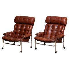 1960s Pair Easy / Armchairs in Chrome and Aged Brown /Cognac Leather by Lindlöfs