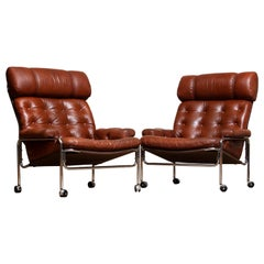 1960s Pair Easy / Armhairs in Chrome and Aged Brown / Cognac Leather by Lindlöfs