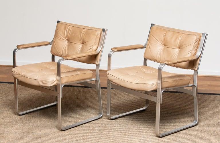 Swedish 1960s, Pair 'Mondo' Arm Club Chairs in Beige Leather by Karl Erik Ekselius JOC