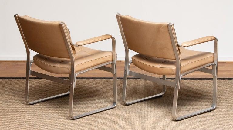 Mid-20th Century 1960s, Pair 'Mondo' Arm Club Chairs in Beige Leather by Karl Erik Ekselius JOC