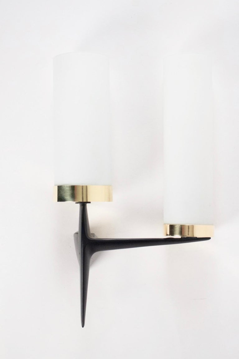 The sconces are made of black satin faceted steel. 