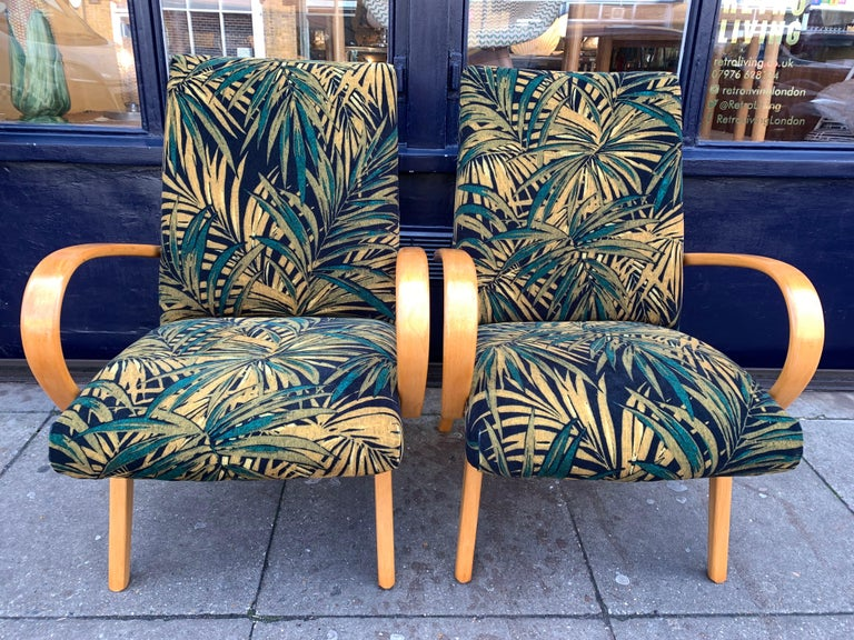 1960s pair of Czech armchairs by Jaroslav Smidek for Ton Factory. Beautifully restored and reupholstered in contrasting green palm fabric from Linwood Fabrics. The frames are made from Purified beech which contrast and highlight the colours and
