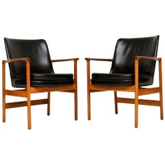 1960s Pair of Leather and Walnut Armchairs by IB Kofod Larsen
