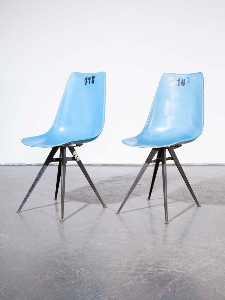 1960s pair of original blue fiberglass side / dining chairs.  1960s vintage pair of original blue fiberglass side / dining chairs. Sourced from a sports stadium outside Prague these numbered chairs have a great shape and a fabulous angular base.