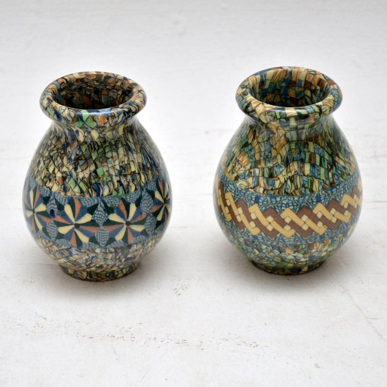 A beautiful pair of ceramic 'Mosaic' vases, these were designed by Jean Gerbino and were made by Vallauris in France in the 1960s. They are signed on the undersides, and they are in superb condition, with no wear or damage to be seen.  Measures: