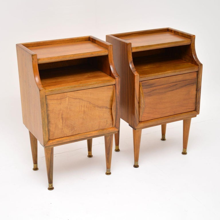 A stunning pair of top quality bedside cabinets in solid walnut, these were made in Italy during the 1960s. They are really well made, very heavy for their size and are in superb condition. We have had these stripped and re-polished to a very high