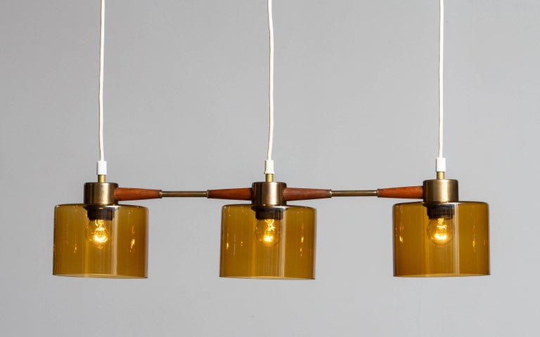 Scandinavian Modern 1960's Pendant with Amber Glass Shades by Carl Fagerlund for Orrefors Sweden For Sale