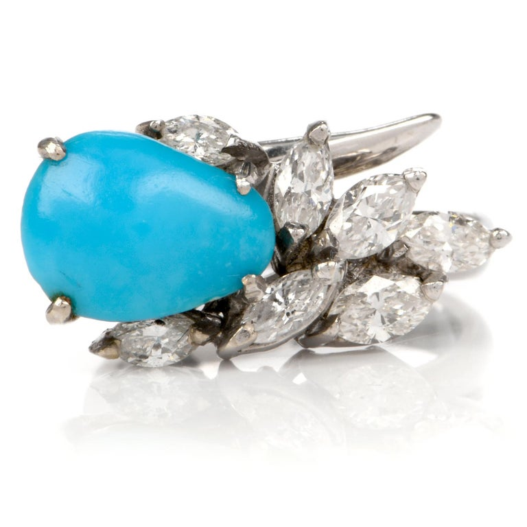 This chic circa 1960s botanically inspired Persian turquoise and diamond cocktail ring is crafted in solid 18 karat white gold, weighing 6.1 grams. Centered with one prong-set pear shaped cabochon finest quality Persian turquoise. Alongside seven