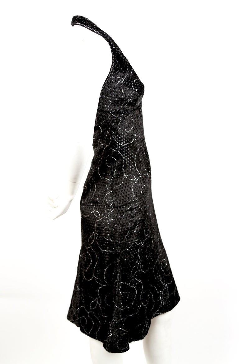 Very rare haute couture silk dress with crystals from Pierre Balmain dating to the 1960's. Fabric is a cut velvet with an interesting diamond shaped pattern throughout. Dress best fits a US size 2-4 (short waisted). Dress measures approximately 32