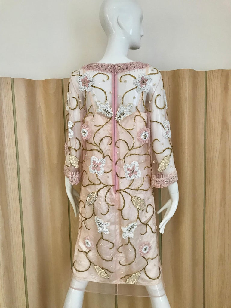 Beautiful vintage 60s Pink Sheer Mesh tunic beaded in white, pink and gold flower beads. Collar and sleeves is beaded in pink beads. Perfect for cocktail party. Tunic comes with slip.   Bust:  38 inches/ Waist: 36 inches/ Hip 36 inches/ Dress