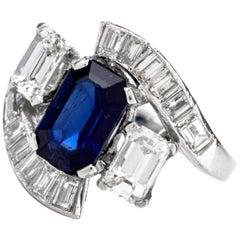 1960s Platinum Baguette Diamond Sapphire Bypass Ring