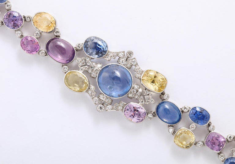 1960's Important Made wide Multi Colored Sapphire with Diamond Bracelet, comprising of Yellow, Blue, Purple, Pink Sapphires, with a center Blue Cabochan  12 Carat Star Sapphire.   Im Surprised this piece isn't signed by an important Jeweler,
