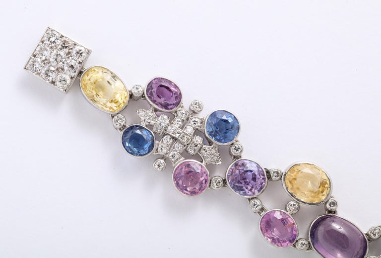 Retro 1960s Platinum Diamond Multicolored Cabochan 12 Carat Star Sapphire Bracelet For Sale