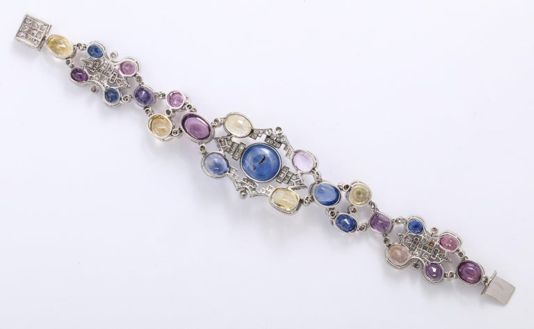 1960s Platinum Diamond Multicolored Cabochan 12 Carat Star Sapphire Bracelet In Good Condition For Sale In New York, NY