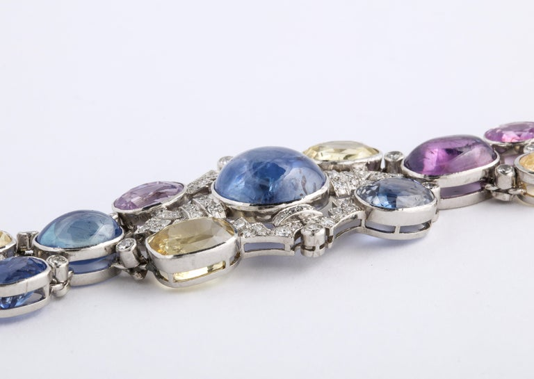 Women's or Men's 1960s Platinum Diamond Multicolored Cabochan 12 Carat Star Sapphire Bracelet For Sale