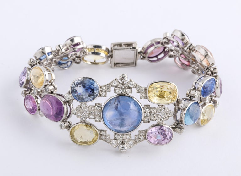 1960s Platinum Diamond Multicolored Cabochan 12 Carat Star Sapphire Bracelet For Sale 1