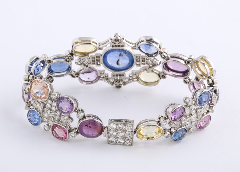 1960s Platinum Diamond Multicolored Cabochan 12 Carat Star Sapphire Bracelet For Sale 2