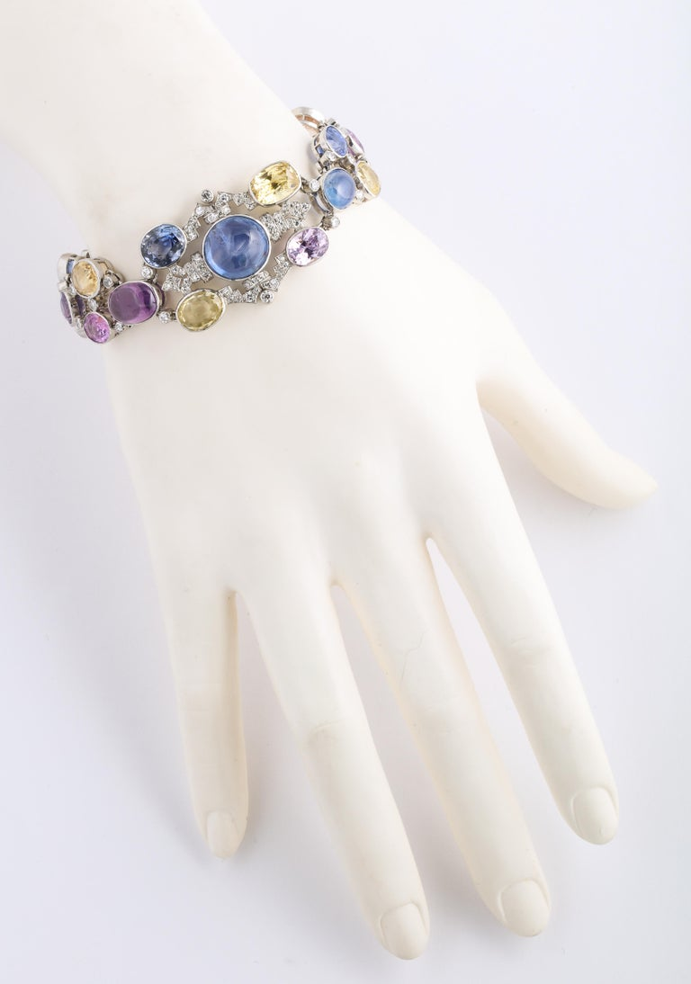 1960s Platinum Diamond Multicolored Cabochan 12 Carat Star Sapphire Bracelet For Sale 3