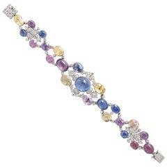 1960s Platinum Diamond Multicolored Cabochan 12 Carat Star Sapphire Bracelet