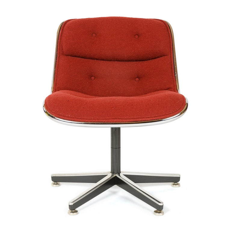 A vintage Pollack executive chair on five leg pedestal base featuring his 'rim technology' of metal edge banding around the chair's periphery separating hard shell frame from upholstery. Original Knoll upholstery.