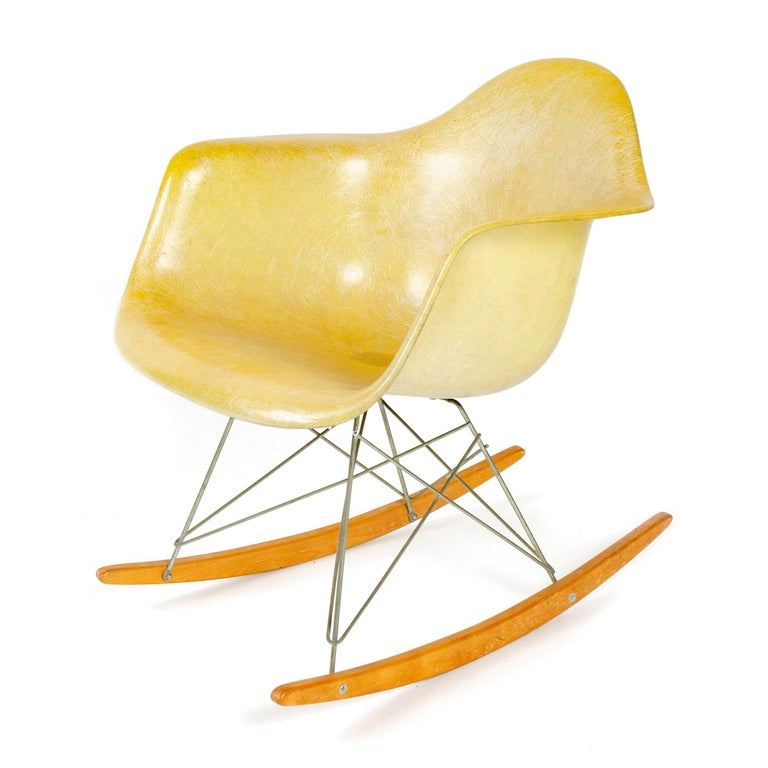 An early example of the iconic RAR rocker with a molded, rope-edged fiberglass seat with large shock mounts, made by Zenith Plastics for Herman Miller, set upon cross-braced steel struts attached to birch runners. Maker's mark on underside.