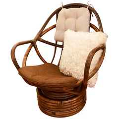 1960s Rattan Swivel Lounge Chair American
