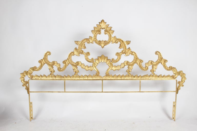 Very Hollywood Regency, Italian Rococo style king headboard with gold gilt. Cast metal, appears to have original gold paint, made in Italy. In very nice condition, very little wear, no breaks. Glamorous!! Mounting hardware is 76