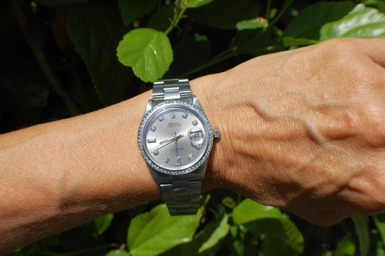 1974's Rolex Oysterdate Precision Watch Diamond Bezel and Dial Silver Mint condition. This watch is a gem!  The condition of the watch is very good as this is a vintage watch model number 6694 Serial number is 3347533 Strap is marke 78350 and is an