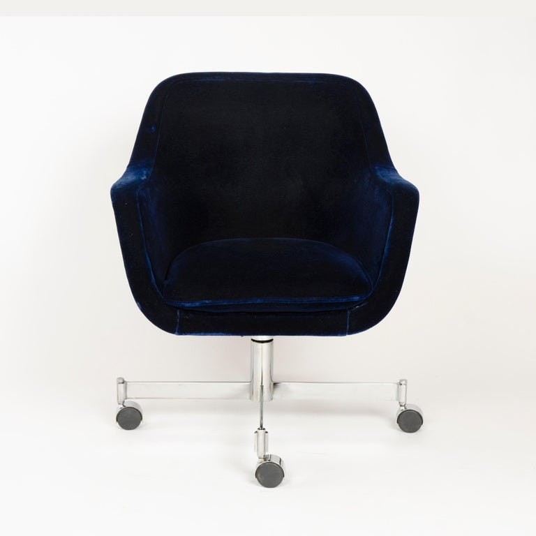 A sculptural barrel-back desk chair with original channel-stitched midnight blue mohair velvet upholstery, on a cruciform caster base. Adjustable seat height between 17-22