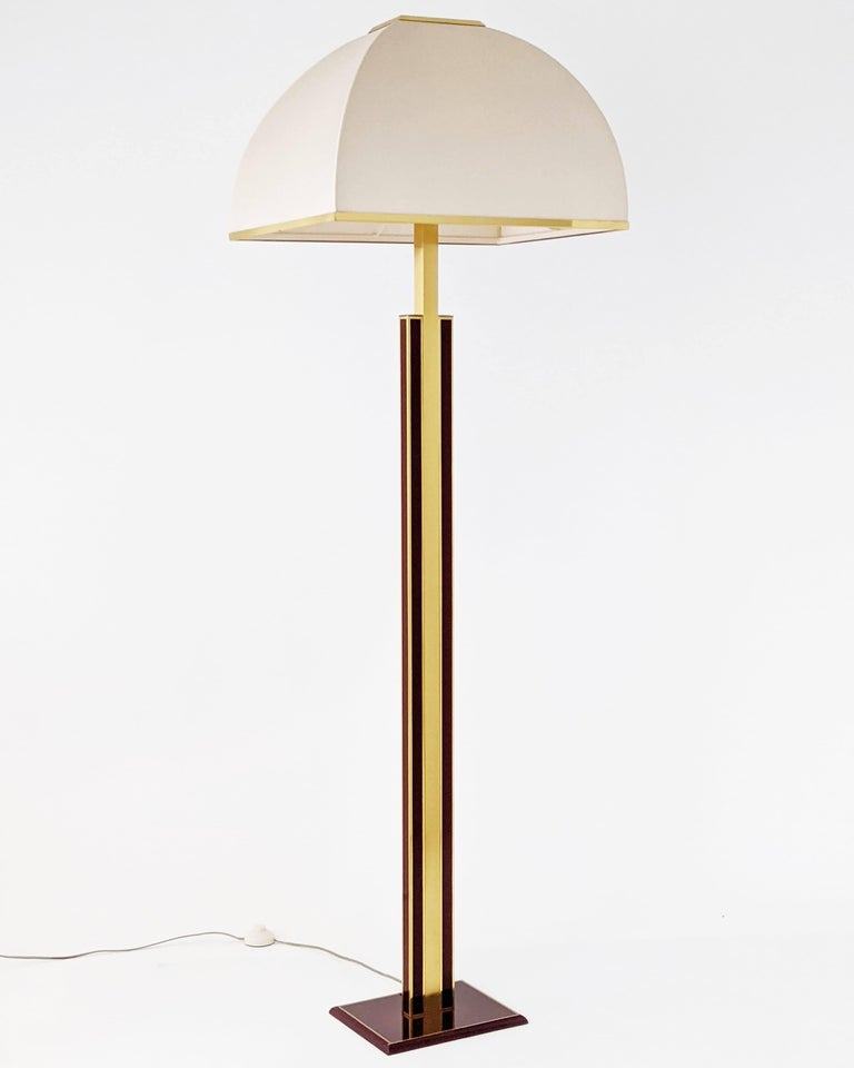 Rare, elegant Romeo Rega floor lamp made of thick brass with original beige fabric washable shade.  Prime quality material, well made with superb attention to detail.  Enameled in a dark red tone with a high gloss lacquered finish.  Shade