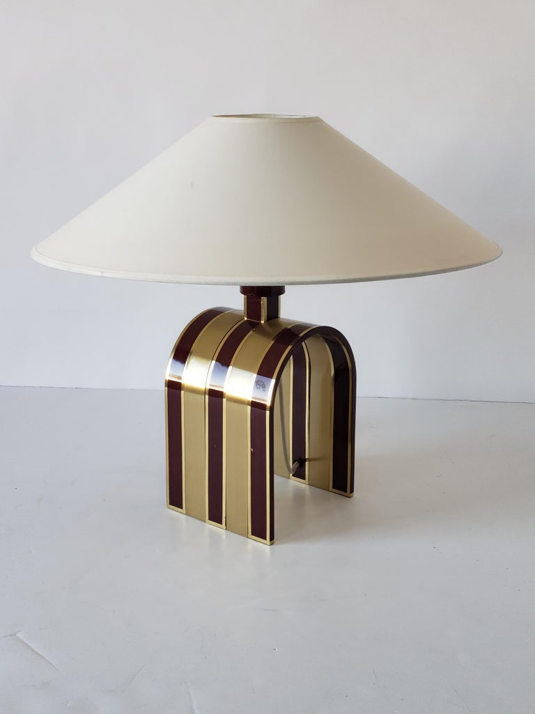 Rare Romeo Rega table lamp made of thick, heavy solid brass.   Enameled in a red wine tone with a high gloss lacquered finish.   E27 socket rated at 100 watt.   Shade come with order.