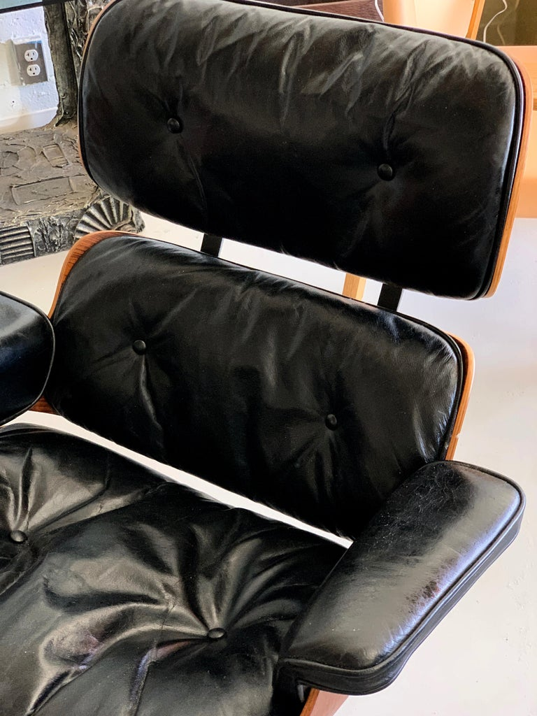 A vintage 1960s rosewood Eames lounge chair and ottoman by Herman Miller. Chair is labeled with a patent number of 3,1xx,xxx. This chair was purchased directly from Herman Miller in the late 1960s. The clips are round, pre-1971. The cushions are