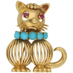 1960s Ruby and Turquoise Cat Brooch in 18 Karat Gold by Hans Georg Mautner