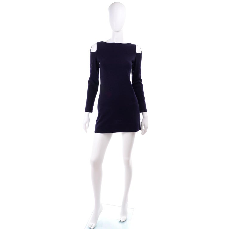 This is a fabulous vintage mini dress designed by Rudi Gernreich in the 1960's. This navy blue wool Harmon Knitwear dress has cutouts at the shoulders, side slit pockets, and closes with a back zipper and a hook and eye. Rudi Gernreich became famous