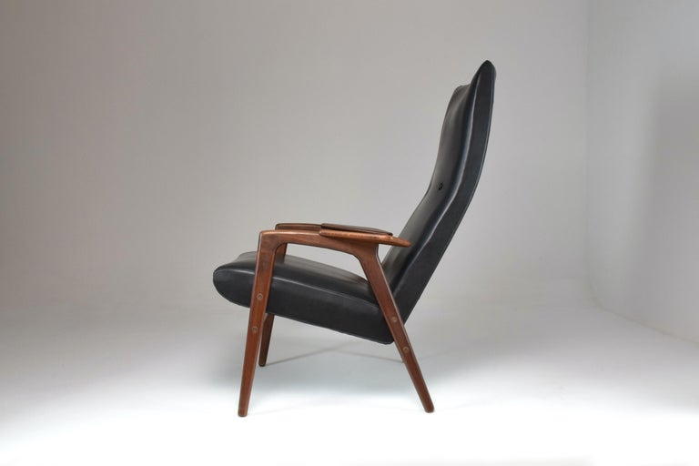 The notable Ruster Danish lounge chair by Swedish designer Yngve Ekström and edited by Pastoe in the 1960s. The leather is in its original condition, the frame has been expertly re-finished.  Yngve Ekstrôm was a designer of Swedish furniture, un