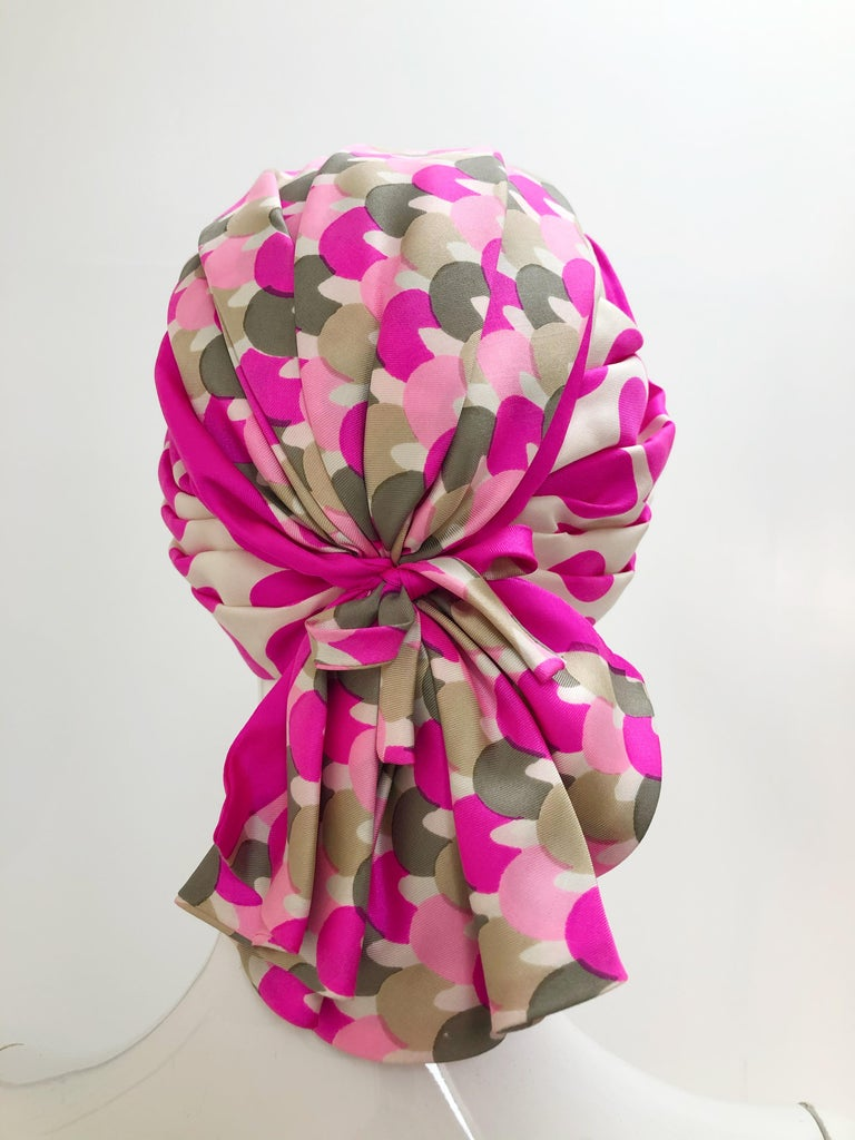 A chic Saks Fifth Avenue 1960s pink polka dot and mixed graphic silk pleated turban with fan-tail pleated flourish at back. Size M-L.