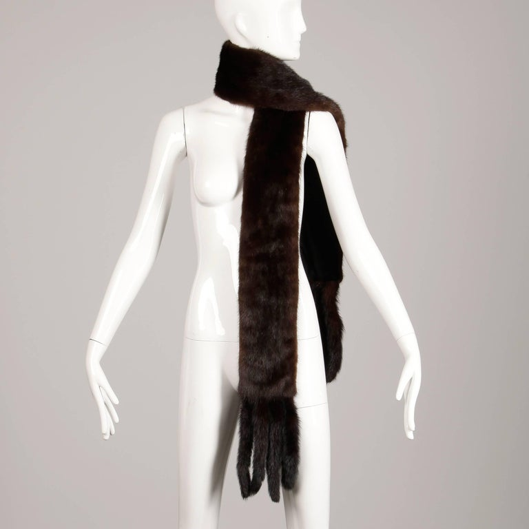 Gorgeous vintage mahogany mink fur scarf or fling with mink tail trim at both ends. Full pelts are in excellent condition and are nice a plush. Fully lined. The width measures 5