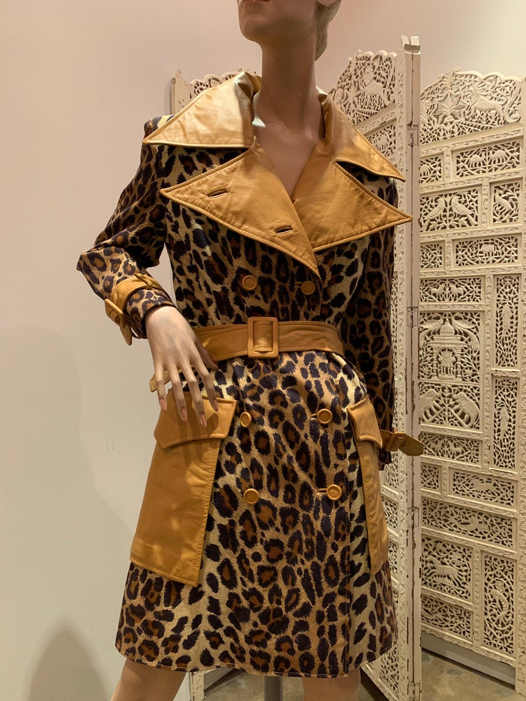 A fabulous late 1960s Samuel Robert leopard stenciled canvas trench coat with butterscotch leather notched collar, belt, buttons and pocket details. Lined in cotton.