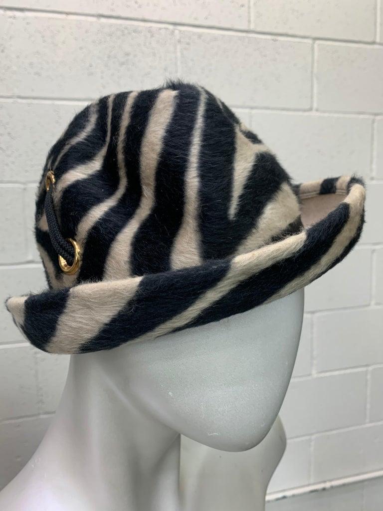 A striking 1960s Mod Schiaparelli Paris zebra striped fur felt narrow-brimmed fedora with gold-tone eyelet and cord lacing details. Size Small.