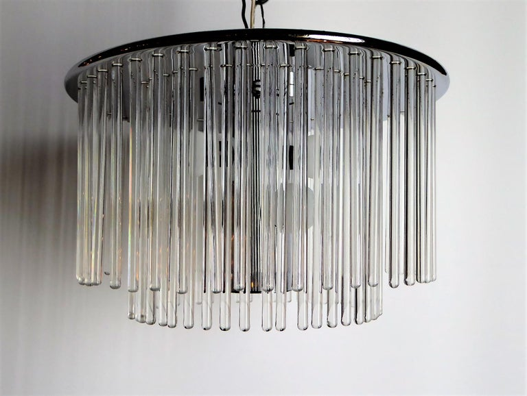 An elegant flushmount with four candelabra lights behind 96 blown glass crystal rods in a two-tier form. Designed by Gaetano Sciolari and imported from Italy by Lightolier, this lamp has a presence and elegance wherever used. The fixture in chrome.