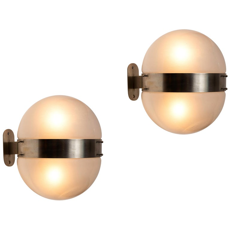 1960s Sergio Mazza 'Clio' sconces for Artemide. Executed in nickeled brass and opaline glass, Italy, circa 1960s. Clean and architectural, these hardwired sconces emit a pleasingly filtered light through its double glass shades.  Price is per item.