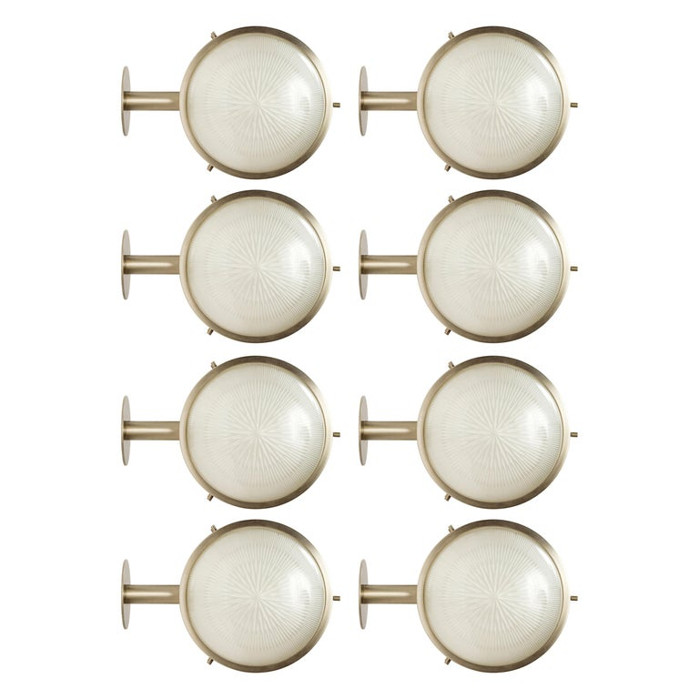 1960s Sergio Mazza 'Gamma' sconces for Artemide. Executed in nickeled brass and pressed opaline glass, Italy.  11 lamps available. Price is per item.  Not UL listed, but recommended UL listing possible from authorized 3rd party vendor upon request